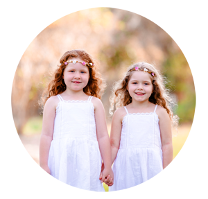 Two girls holding hands at their family session.