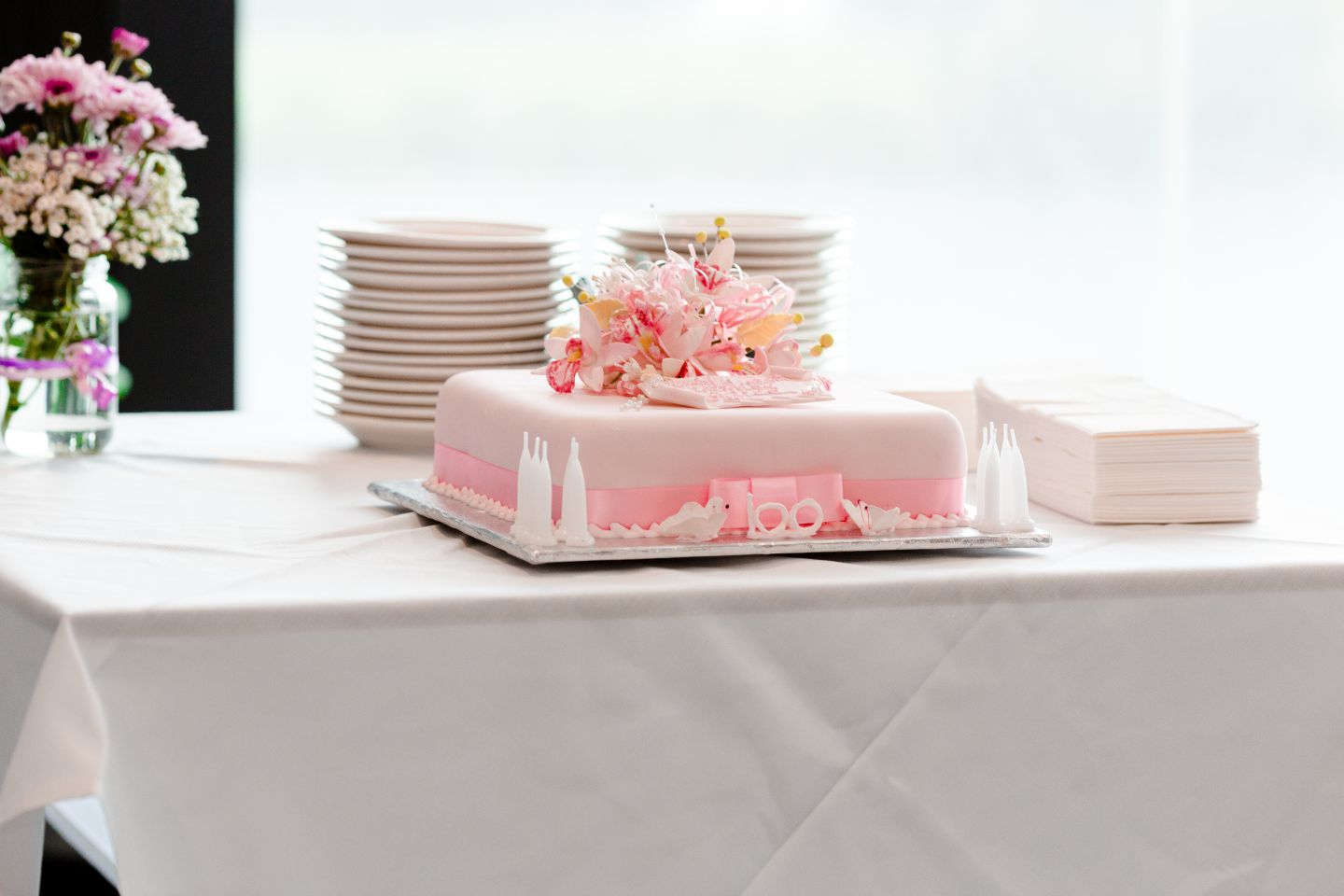 A gorgeous pink cake baked to celebrate a 100th birthday party.