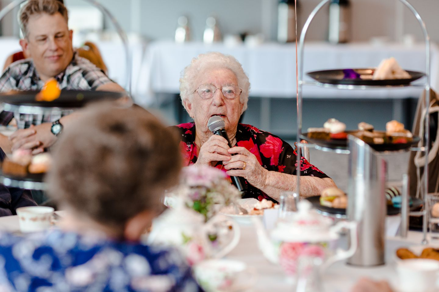 A lady giving a speech at her 100th birthday party in North Lakes.