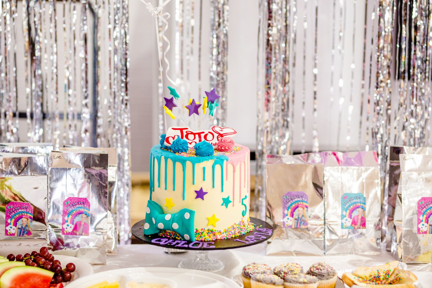 A Jojo Siwa birthday cake and decorations at a children's party in Caboolture.