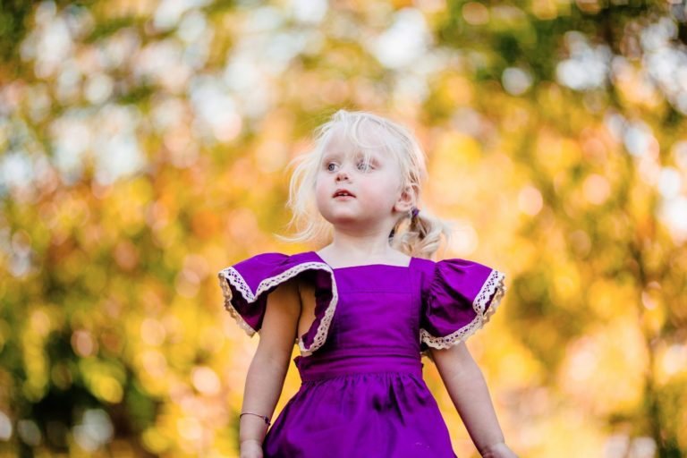 A little girl in purple looks to her mother in Burpengary.