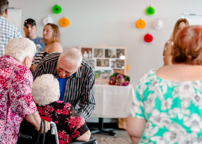A man celebrating a 100th birthday party in North Lakes.