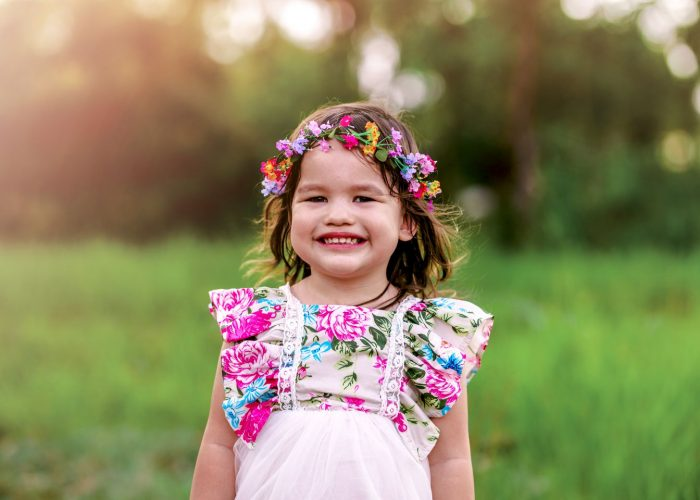 A girl wears a beautiful flower crown at her portrait photography session.