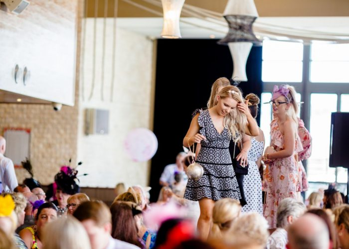 Ladies modelling clothing at The Mon Komo's Cup event at Redcliffe.